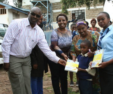 Rotary club of Ngong present dictionaries to Mama and the children